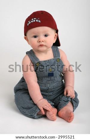 cute baby boy in overalls and hat