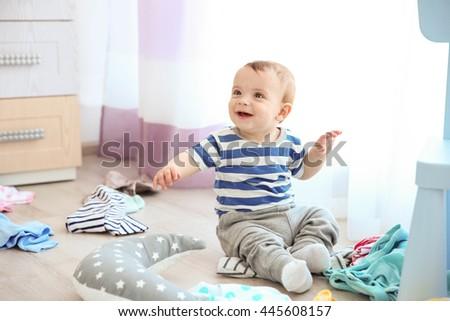 cute baby boy in room