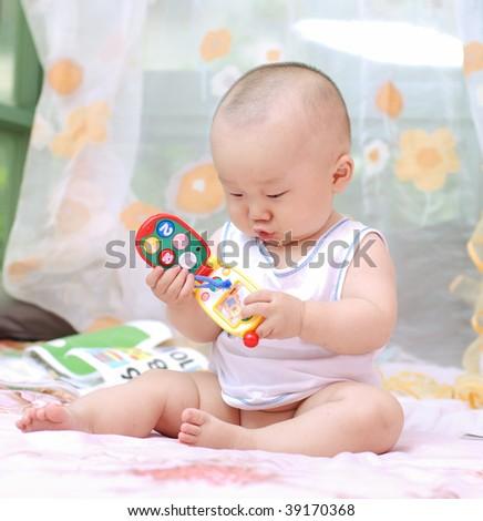 cute baby boy playing toy