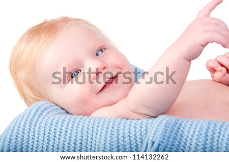 Cute Baby boy's portrait on blue blanket
