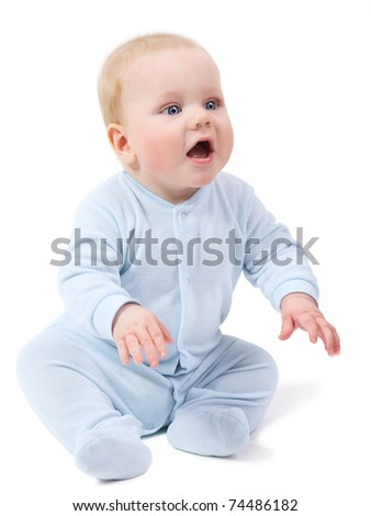 Cute baby boy sitting on a floor, isolated on white - stock photo