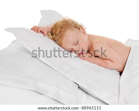 Cute baby boy sleeping on white pillow