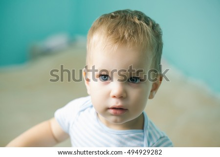 51a27880f Cute baby boy with beautiful blue eyes blond hair and innocent look ...