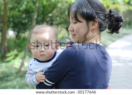 cute baby boy  with his mother