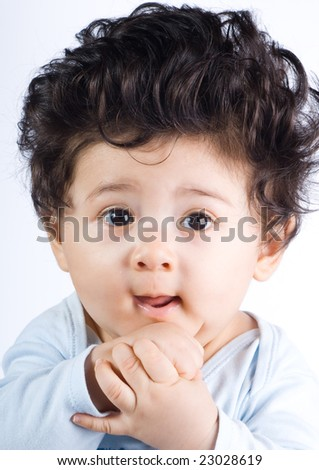 cute baby boy with long hair stock photo 23028619