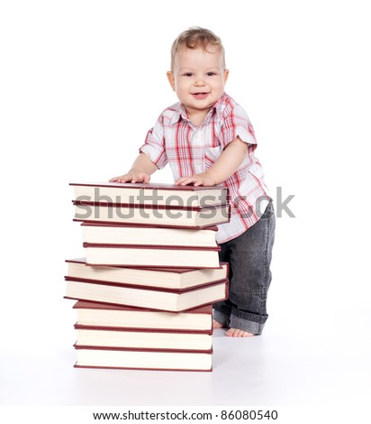 cute baby boy with many books isolated on white background