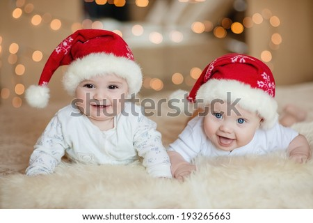 Cute baby boys in Santa hat