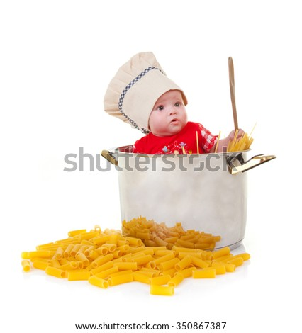 Stock Photo Cute baby chef in a huge Pot with pasta on white background.