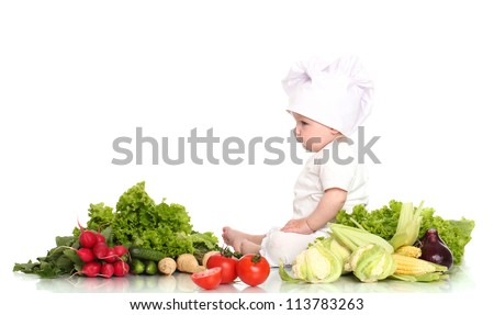 Cute baby chef with different vegetables over white background