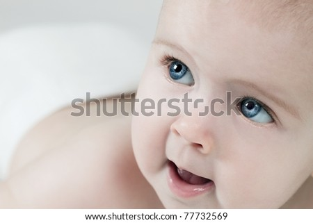 Cute baby face with blue eyes
