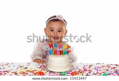 Cute baby girl and a birthday cake