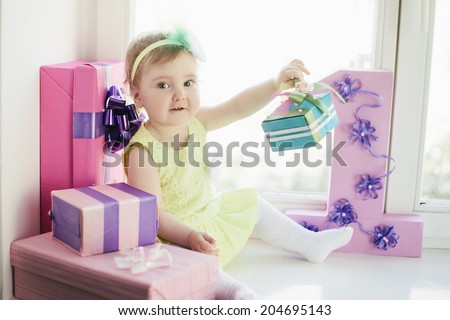 cute baby girl celebrating first birthday