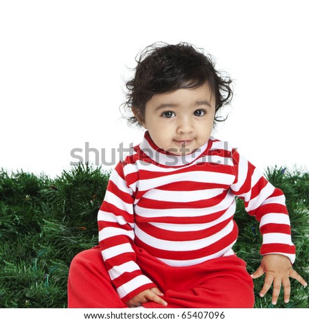 Cute Baby Girl Dressed in Red in front of a Christmas Background ...