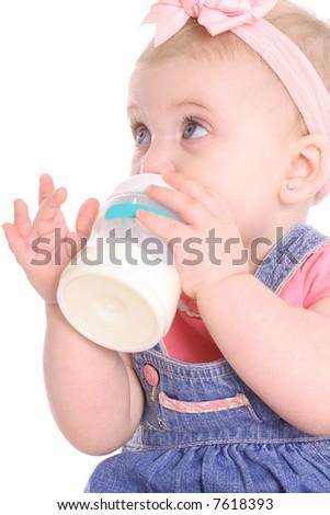 cute baby girl drinking a bottle