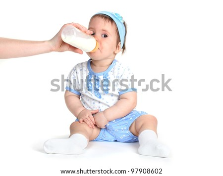 Cute baby girl eating isolated on white - stock photo