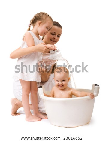 Cute baby girl having bath. Isolated over white