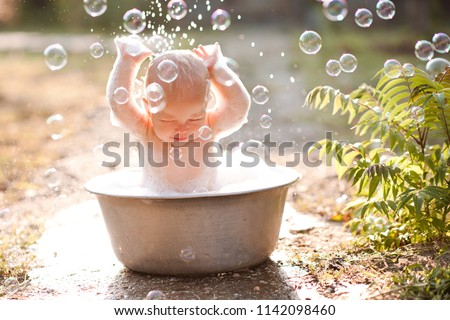 Cute baby girl having bath outdoors close up. Childhood.  Сток-фото ©