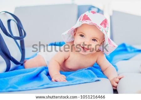 cute baby girl in a sun hat...