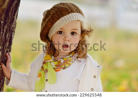 cute baby girl in fall time