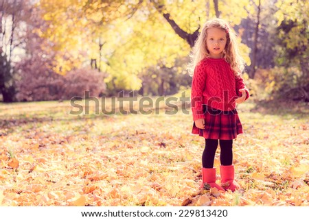 Stock Photo Cute baby girl in the autumn forest