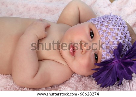 Cute baby girl lying on her back relaxing