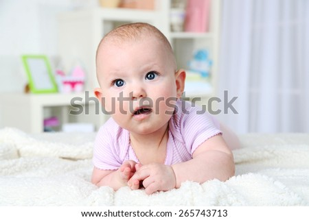 Cute baby girl, on home interior background