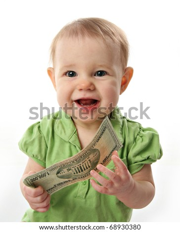 Cute baby girl smiling holding on to a million dollar bill  money