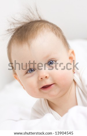 Cute baby girl smiling, white background.