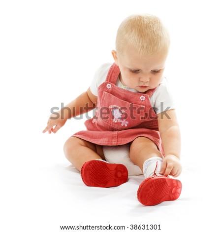 Cute Baby Girl wearing her Shoes