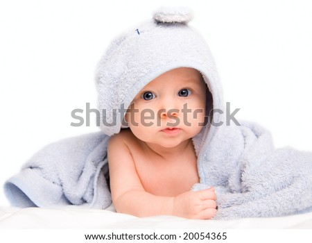 Cute baby girl with towel after bath. Studio shot. Isolated on white