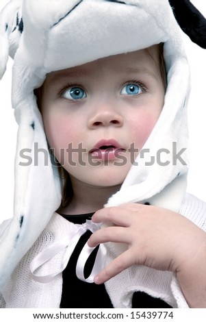 Cute baby girl with white hat looking up