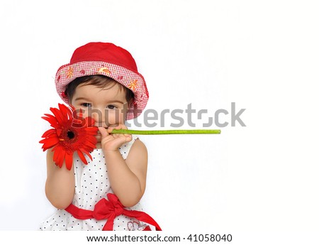 Cute baby holding a flower