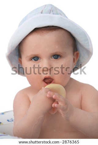 Cute baby in a hat taking a bath