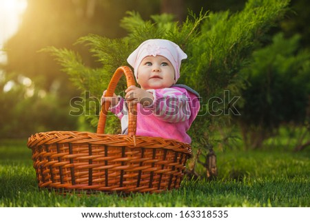 cute baby is playing in the park