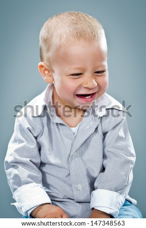 Cute Baby Laughing Over Grey Background
