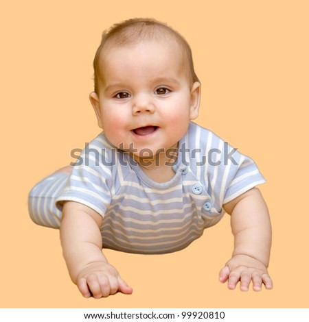 Cute baby lying isolated on a beige background
