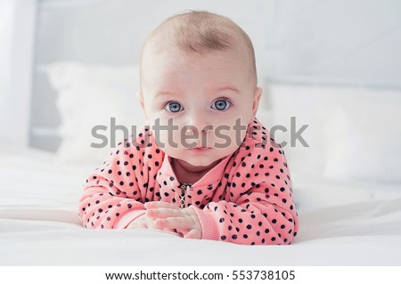 Cute baby on the white bed #553738105