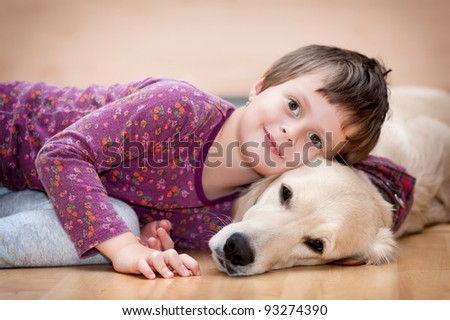 Cute baby playing with his dog