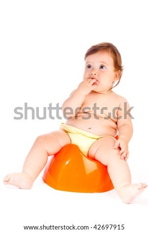 Cute baby sitting on the orange potty