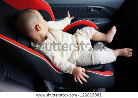 cute baby sleep in the baby car seat at the front car seat
