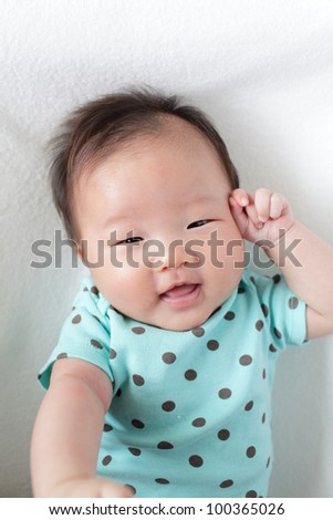 cute baby smile face (baby are two months) , child is a asian girl