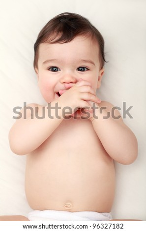 Cute baby sucking his hands