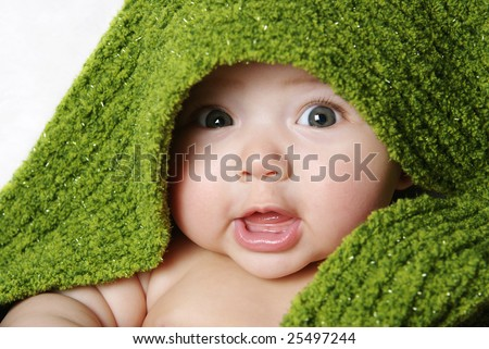 cute baby under a green blanket