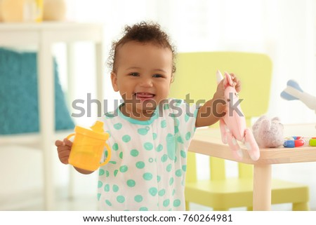 cute baby with bottle of water...