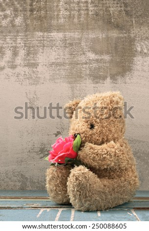 cute bear doll holding rose bouquet in vintage style