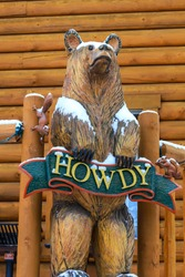 Cute bear welcoming wood carving with howdy sign