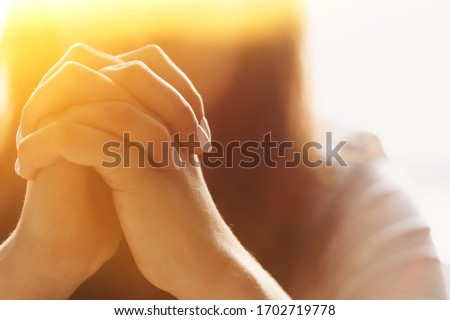 Cute beautiful girl folded her hands in prayer. A woman asks God for help Foto d'archivio ©