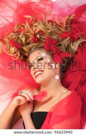 Cute, beautiful, sexy valentine girl lying on the floor