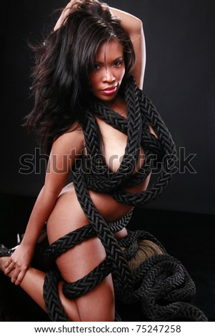 Cute black girl dressed with marine rope