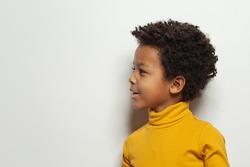 Cute black kid boy, child face profile portrait
